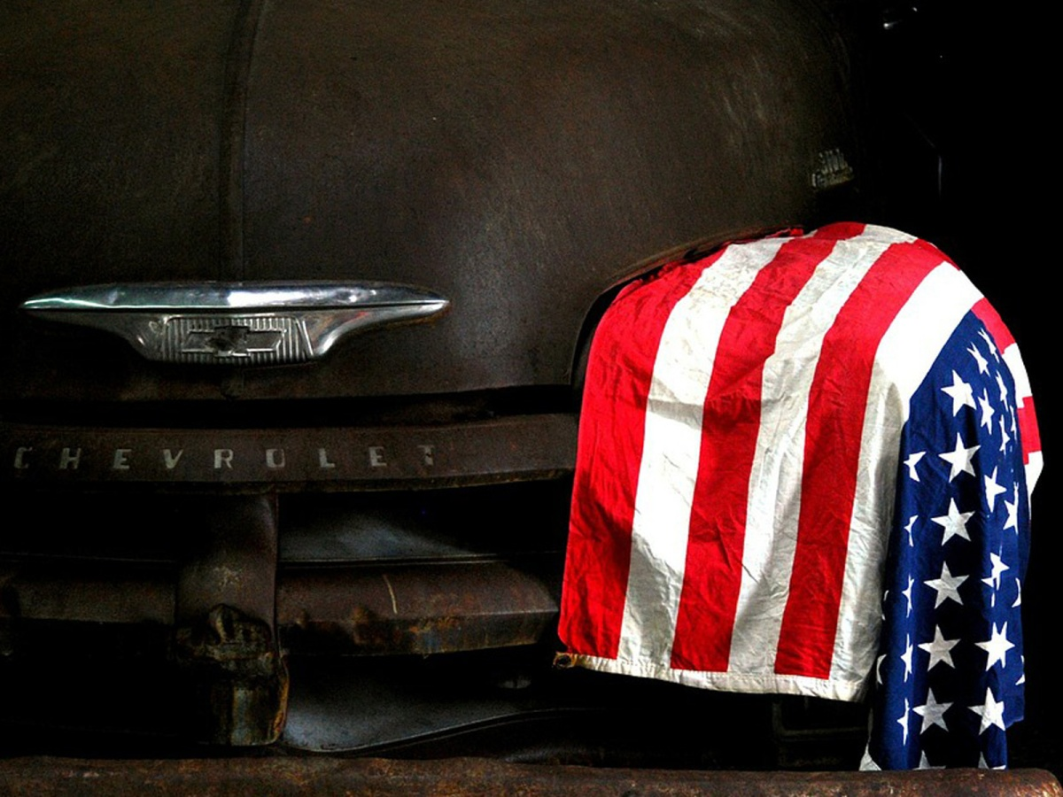 Old Chevrolet pickup with American flag